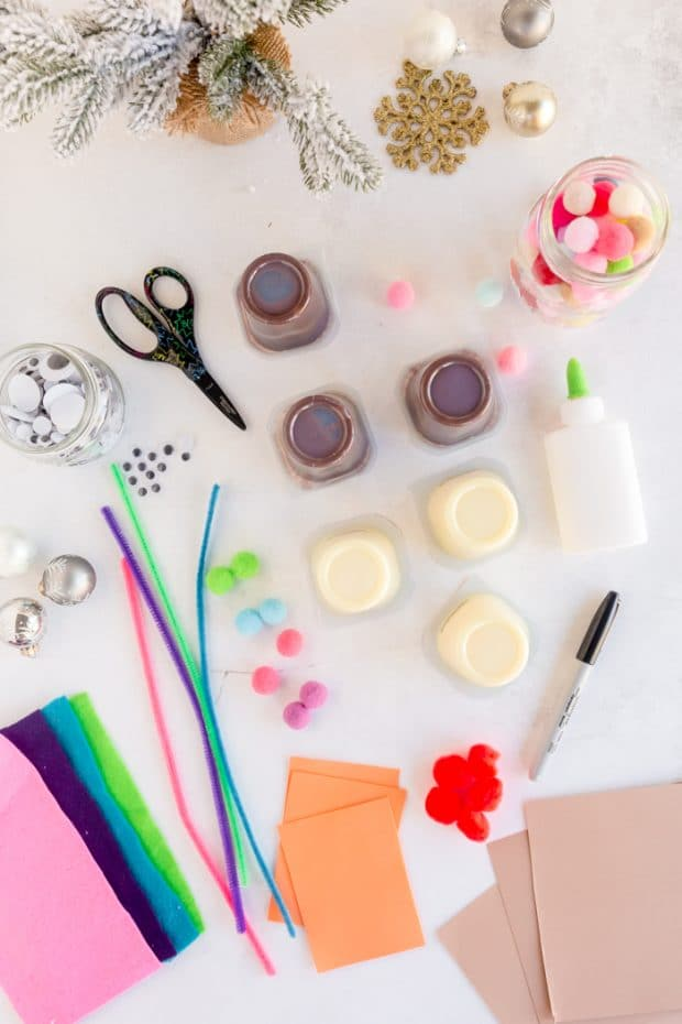 supplies needed for pudding cups- pudding cups, felt, pipe cleaners, pom poms, glue, googly eyes, cardstock
