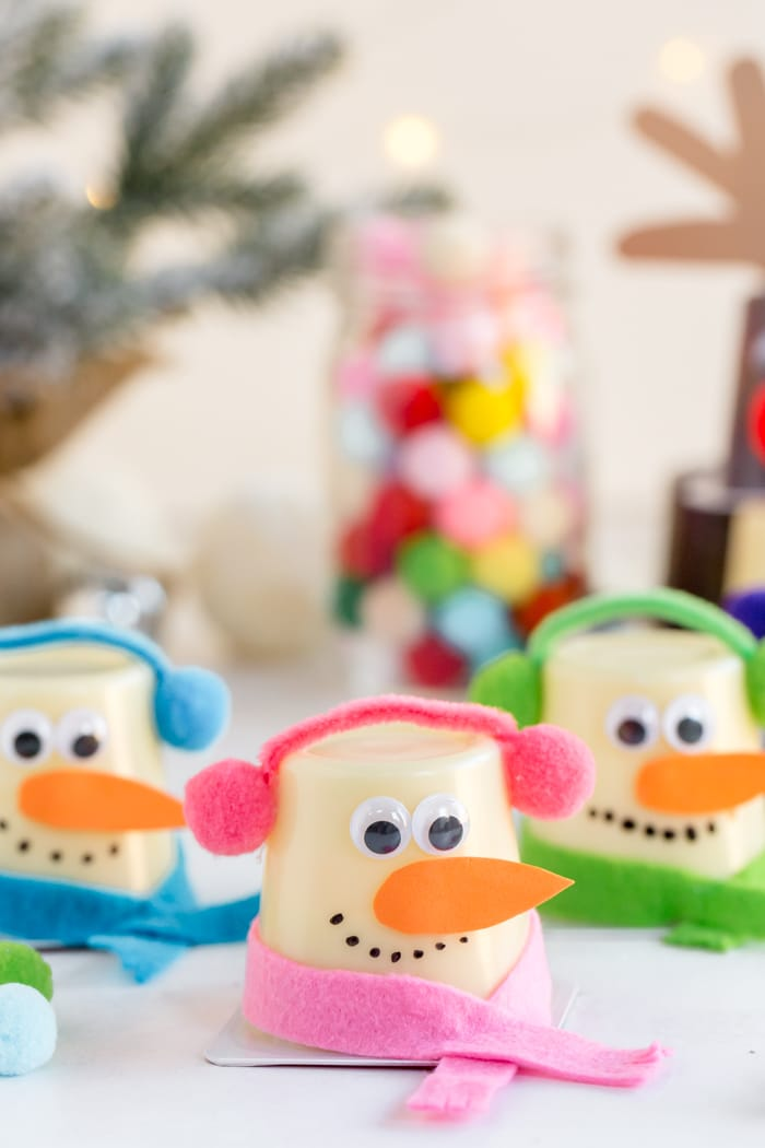 snowman pudding cup wrapped in pink accessories