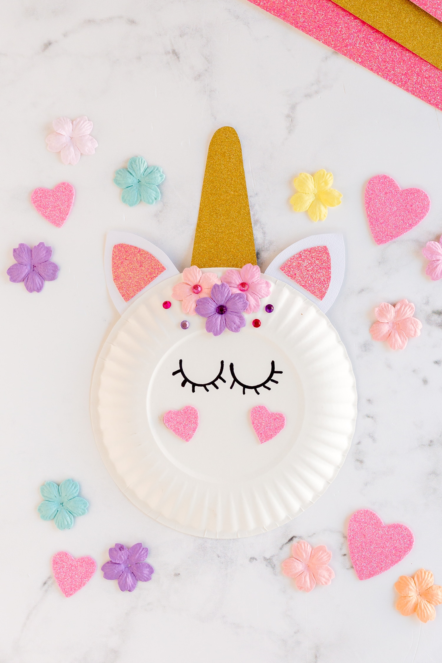 paper plate unicorn with purple and pink flowers