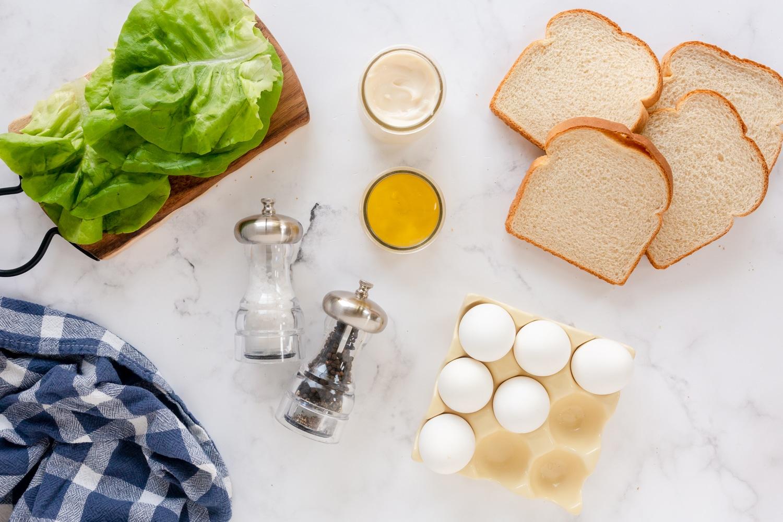 egg salad ingredients: egg, mayo, mustard, salt and & pepper