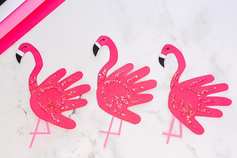 three flamingos in a row
