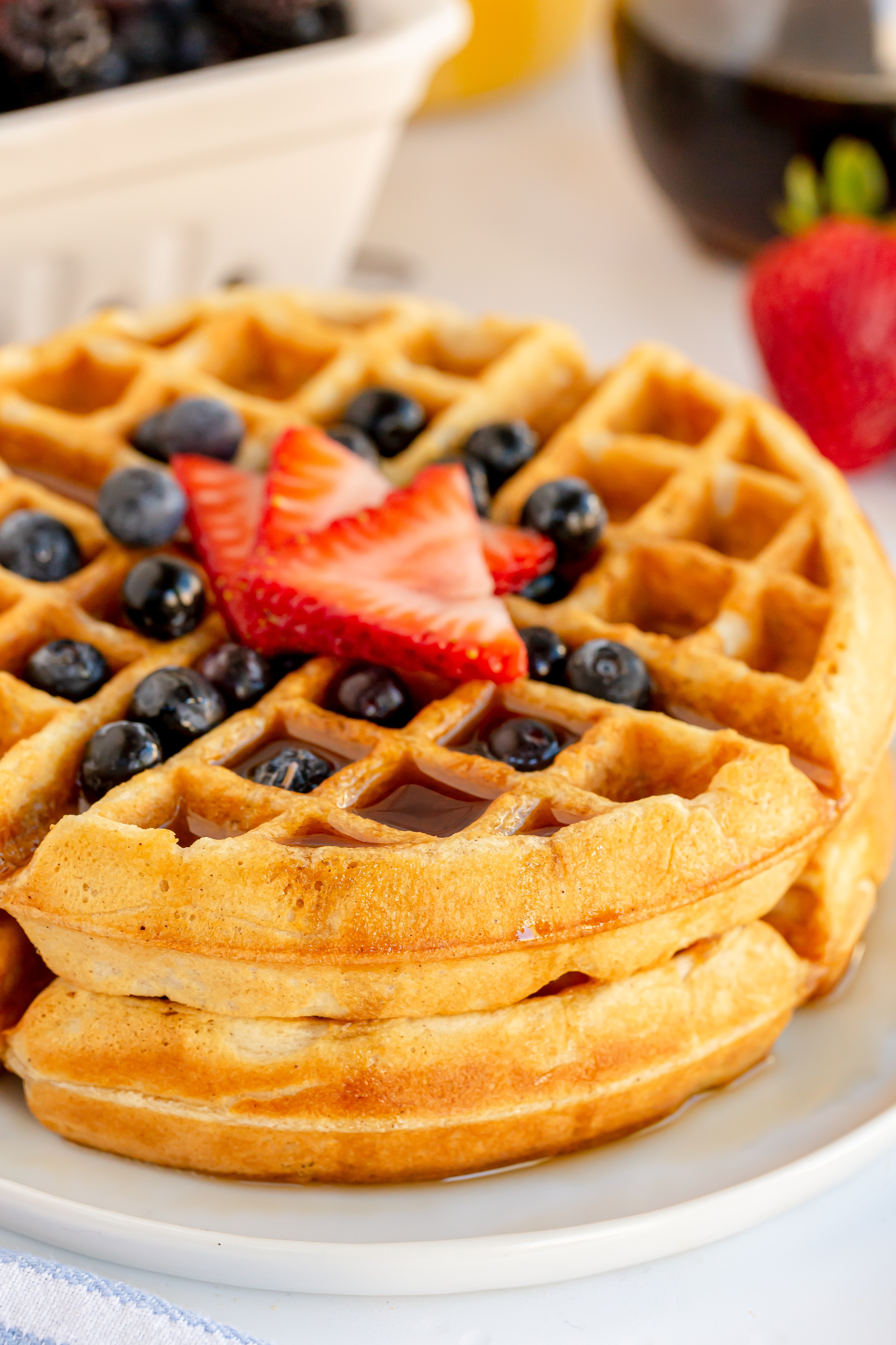 homemade waffle with berries and syrup