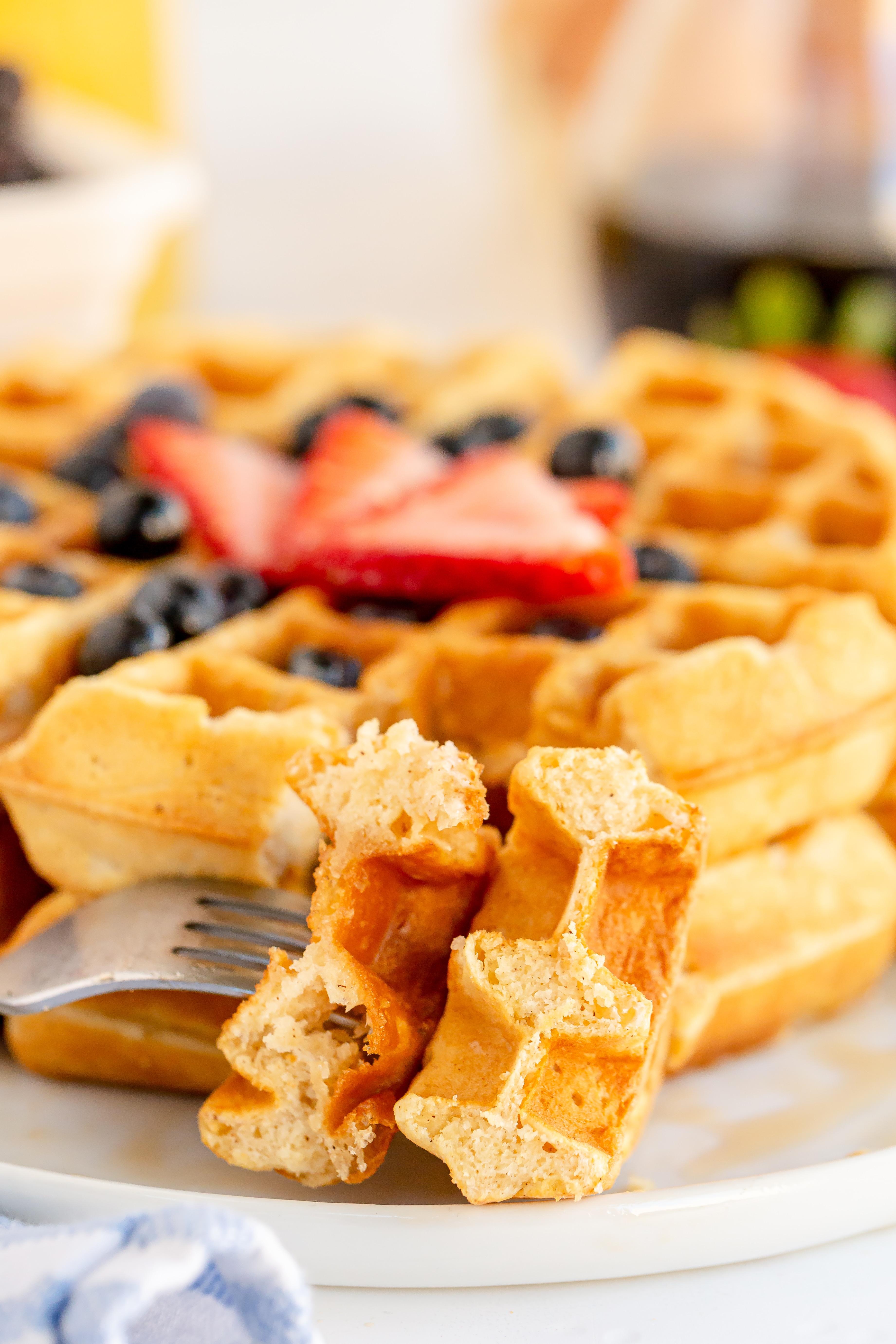 bite of homemade waffles