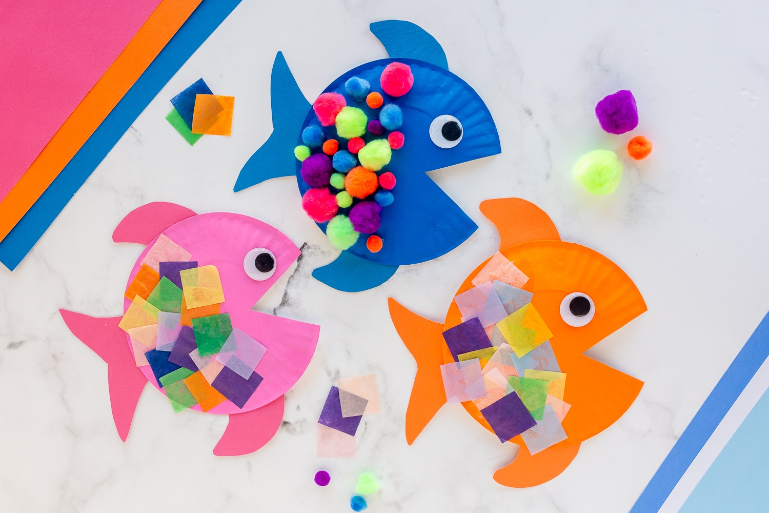 paper plate fish with tissue paper squares and pom poms
