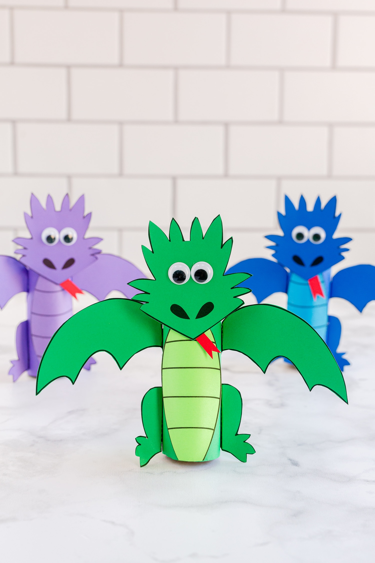 Toilet Paper Roll Dragons on counter- green, blue, and purple dragons