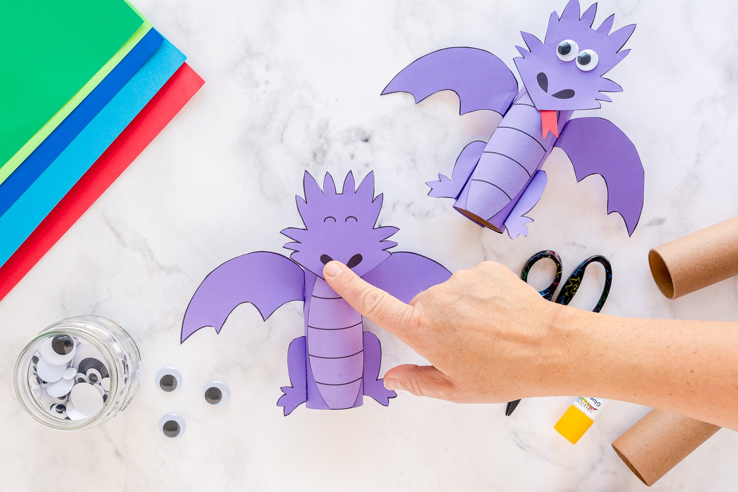 glue dragon pieces on paper roll