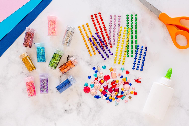 gemstones and glitter bottles on counter