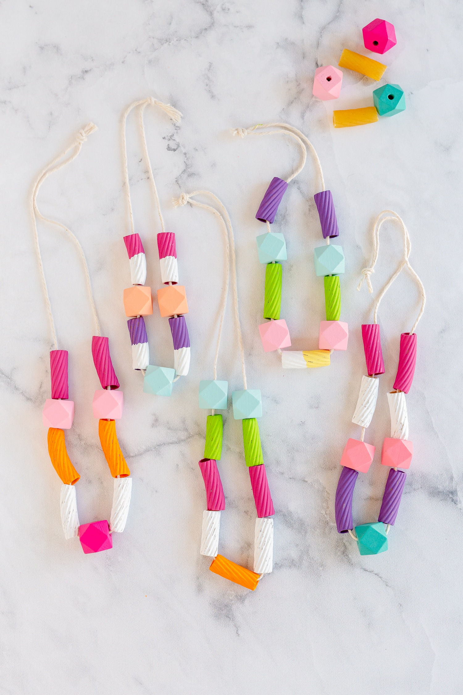 A mixture of colorful wooden beads and pasta makes these DIY Pasta Necklaces such a fun and simple craft the kids will love to make and wear!