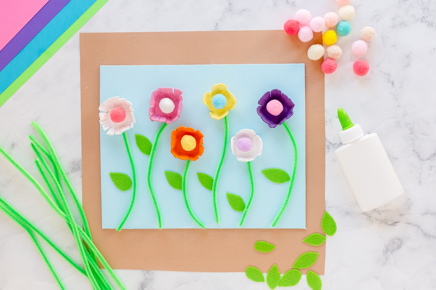 add pipe cleaners and felt leaves to canvas