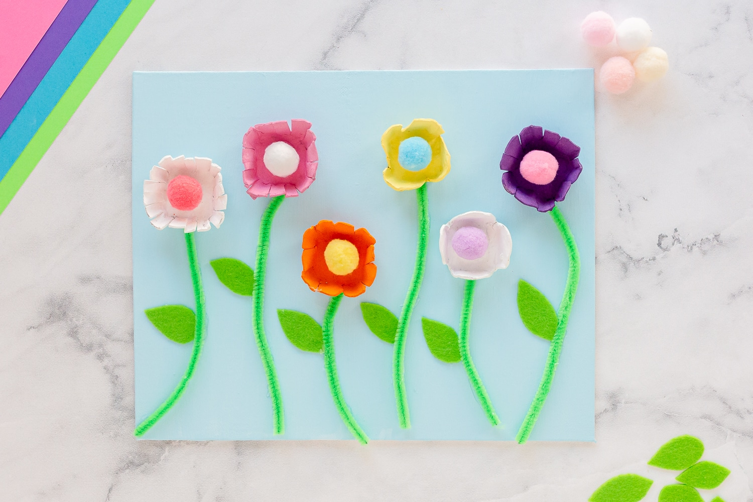 Egg Carton Flowers displayed on canvas