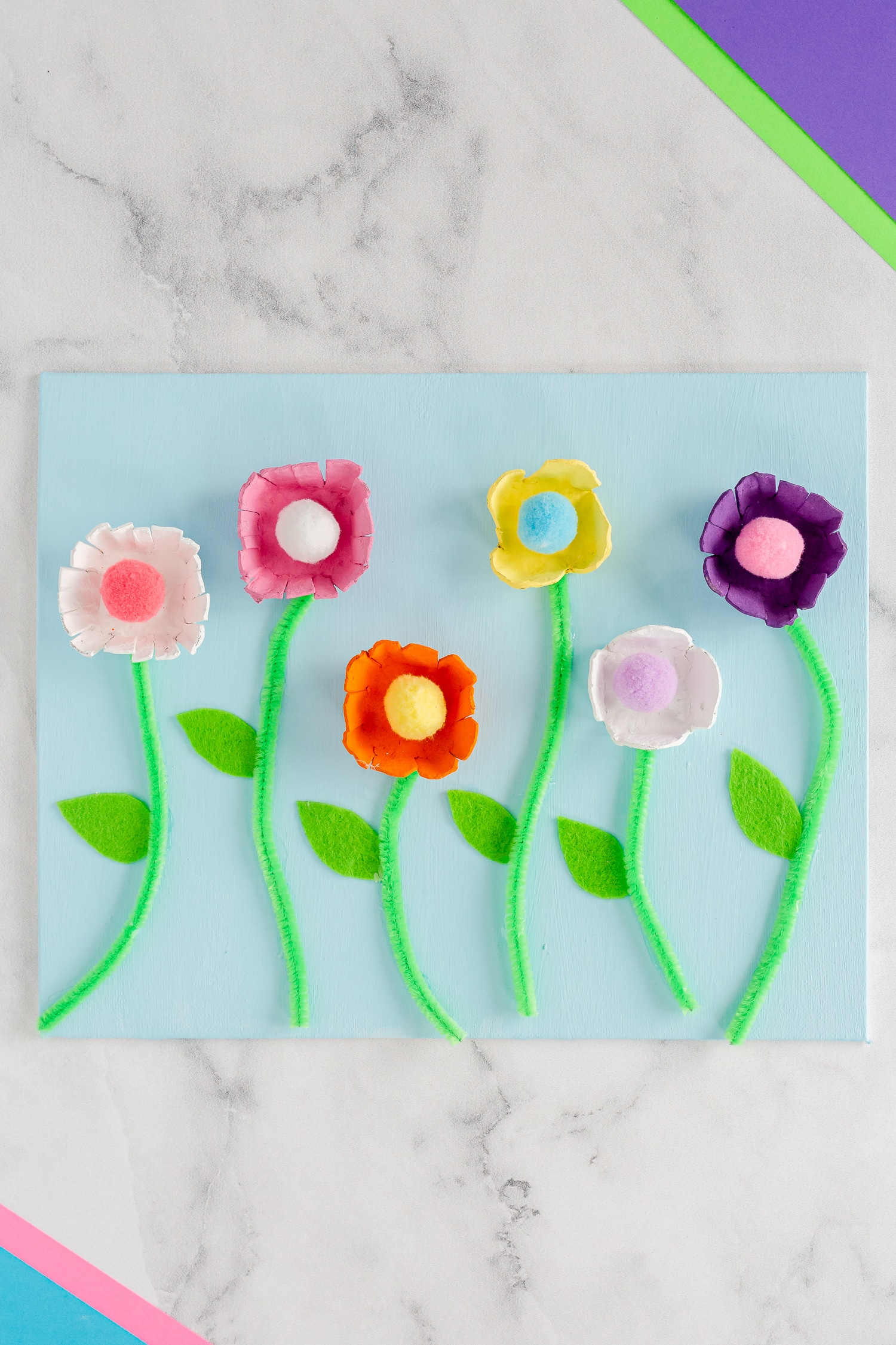 These Egg Carton Flowers are such a fun and pretty craft to celebrate the spring and summer season using recycled cardboard egg cartons and a few other craft supplies!
