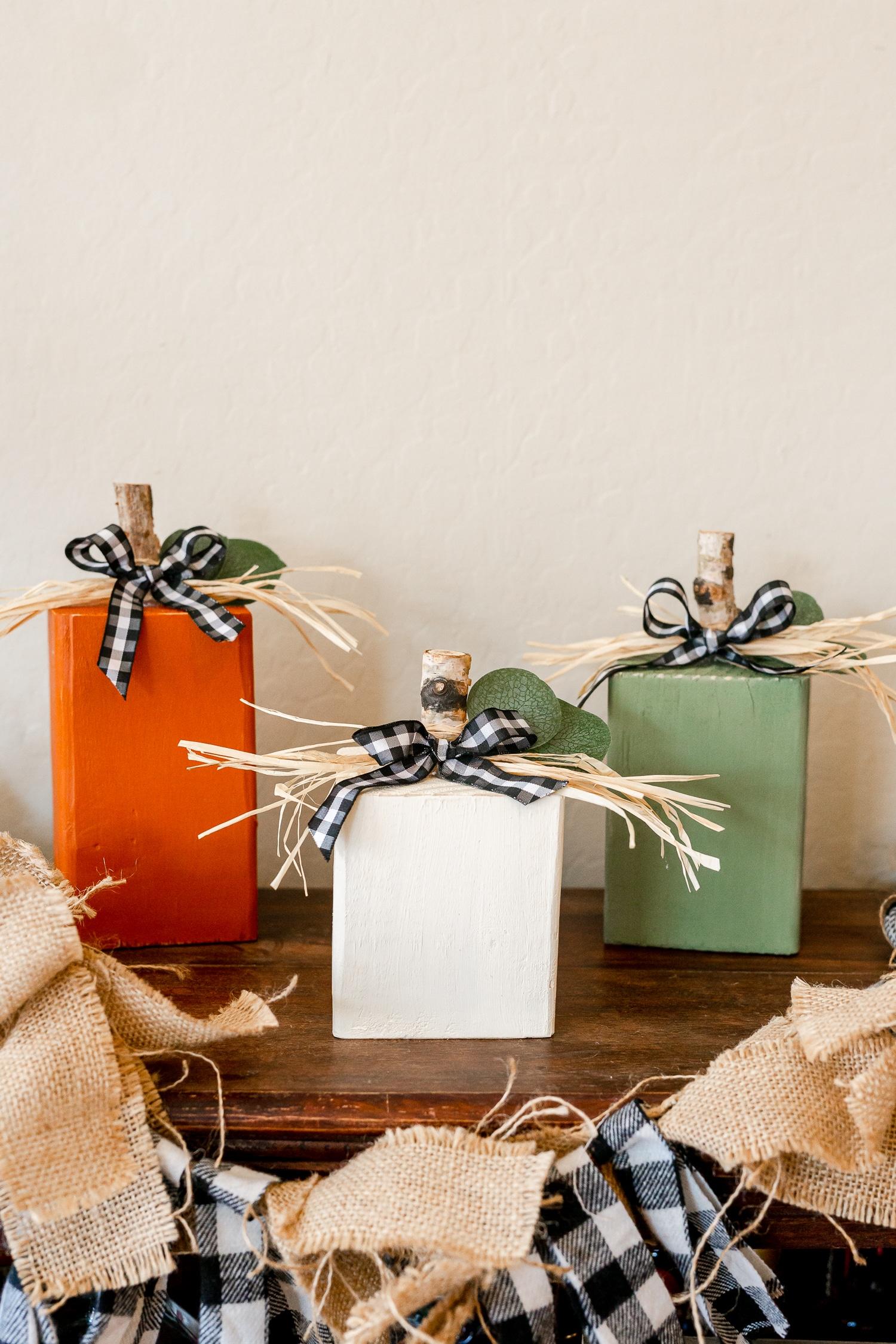 4 x 4 Wooden Pumpkins on Brown Shelf