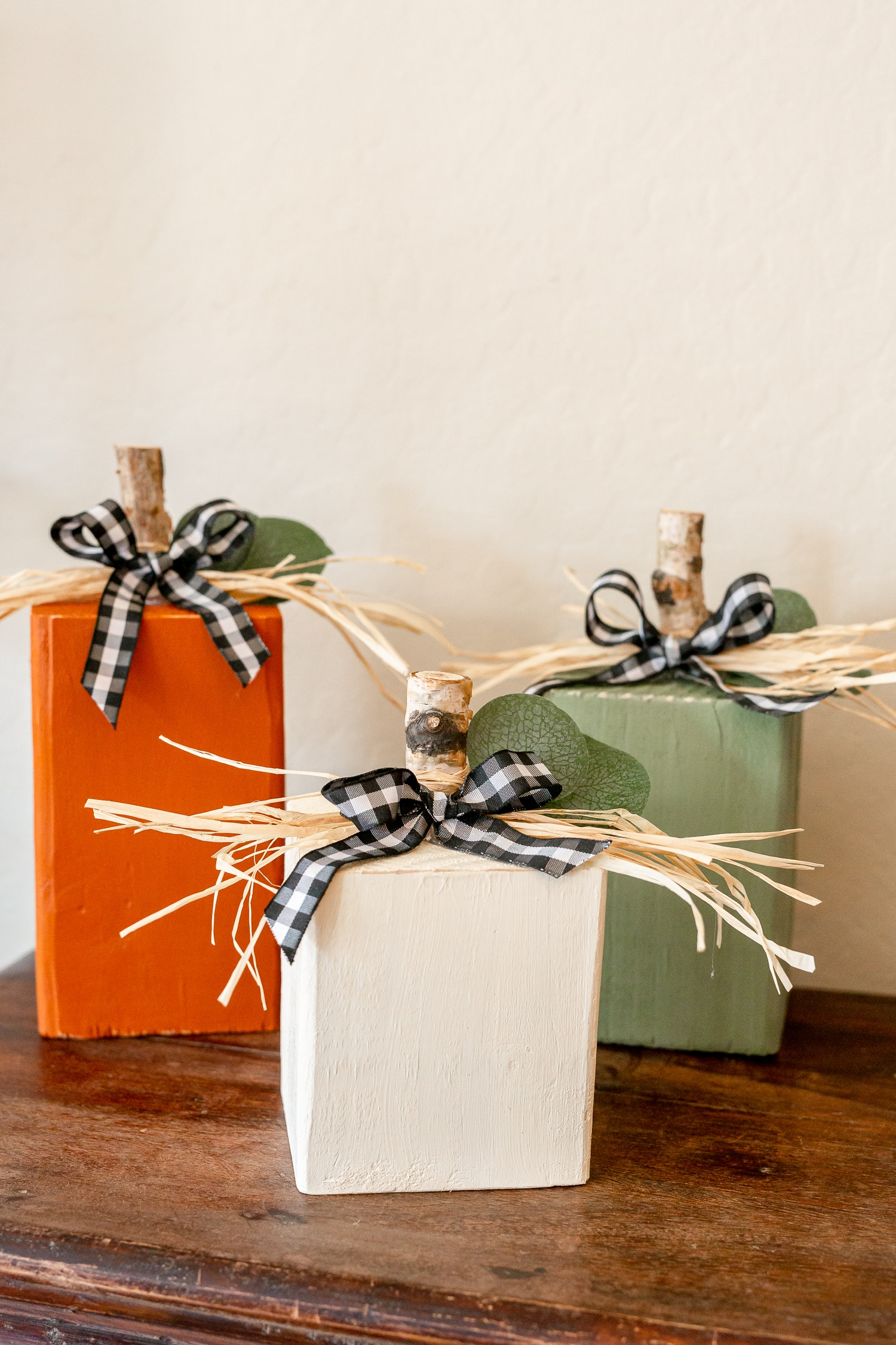 four wooden pumpkins used as Fall decor