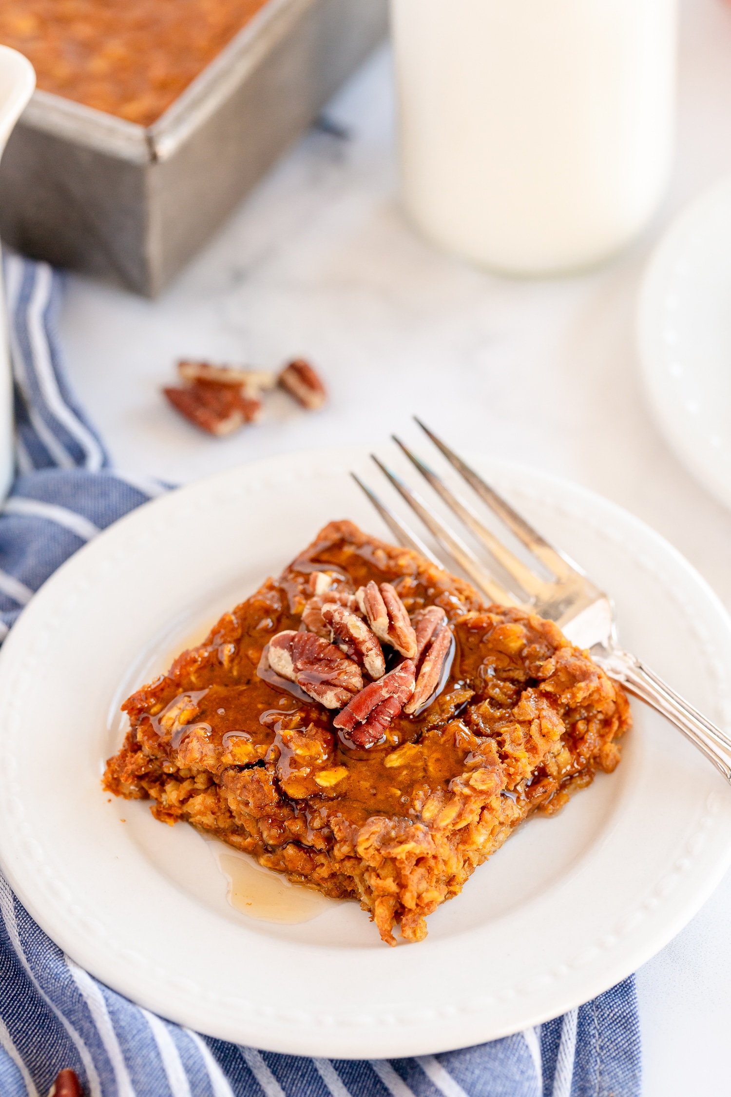 Pumpkin pie Oatmeal square on plate with maple syrup