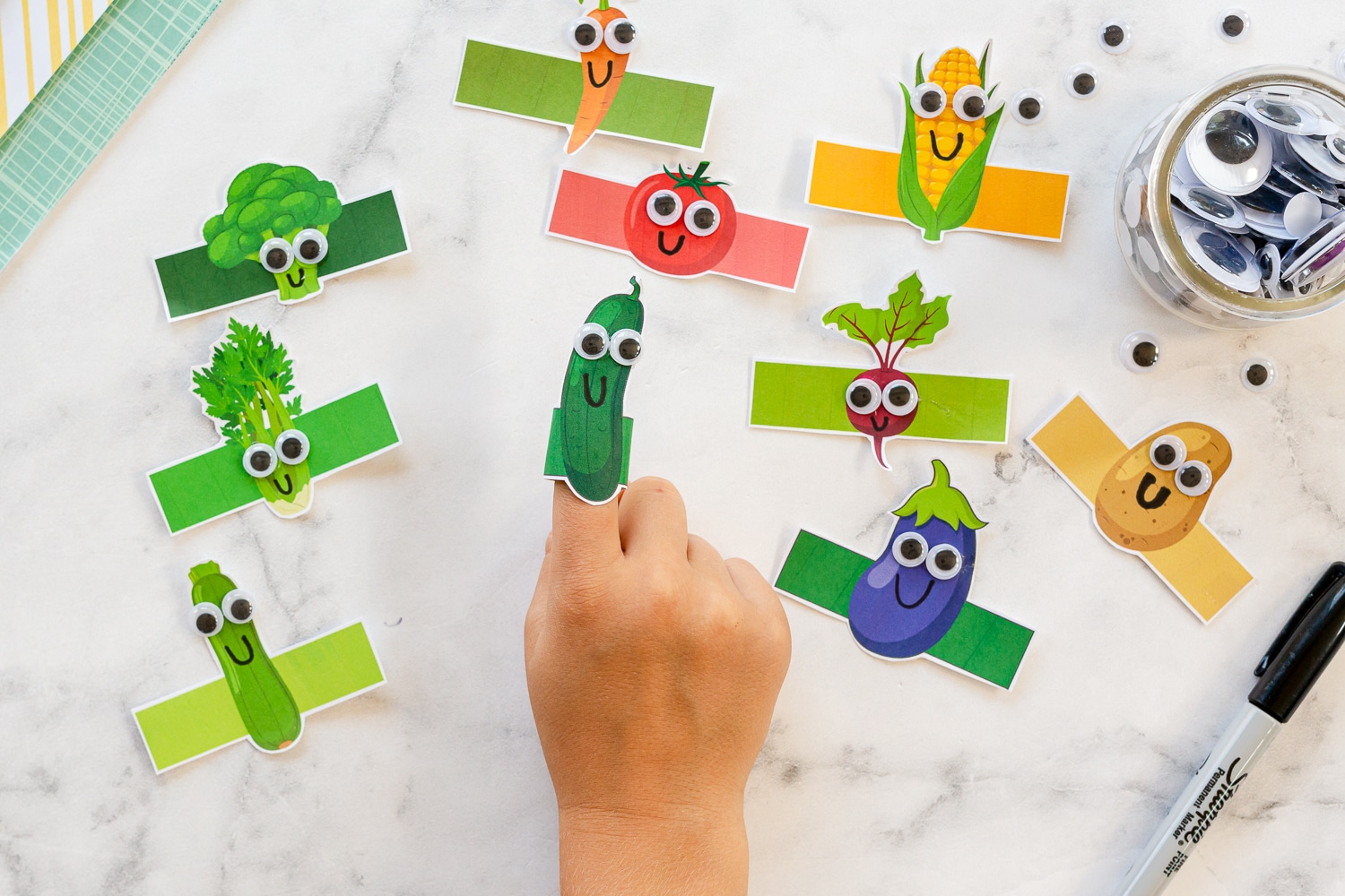 googly eyes added to veggie finger puppets