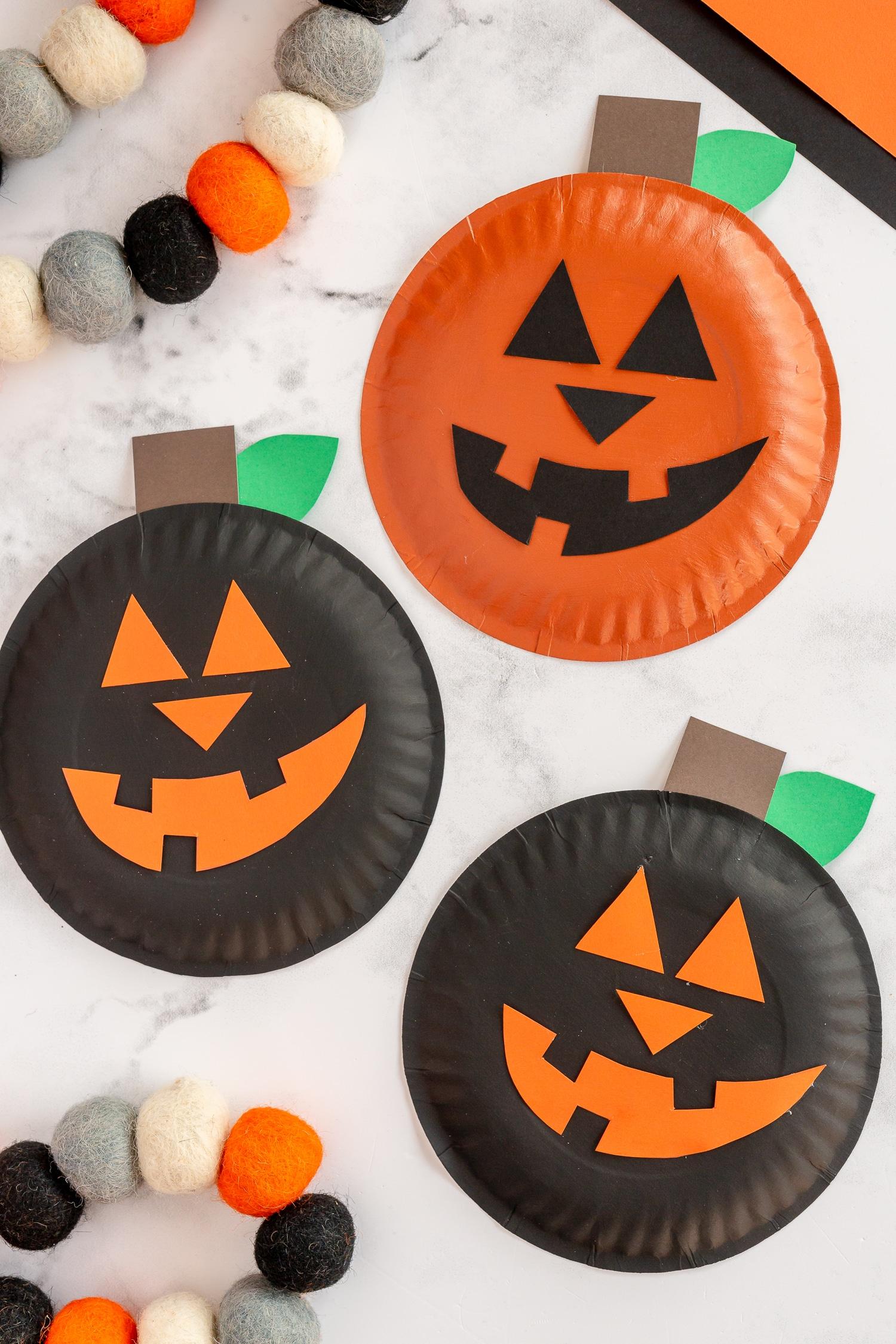 Three paper plate pumpkins - black and orange