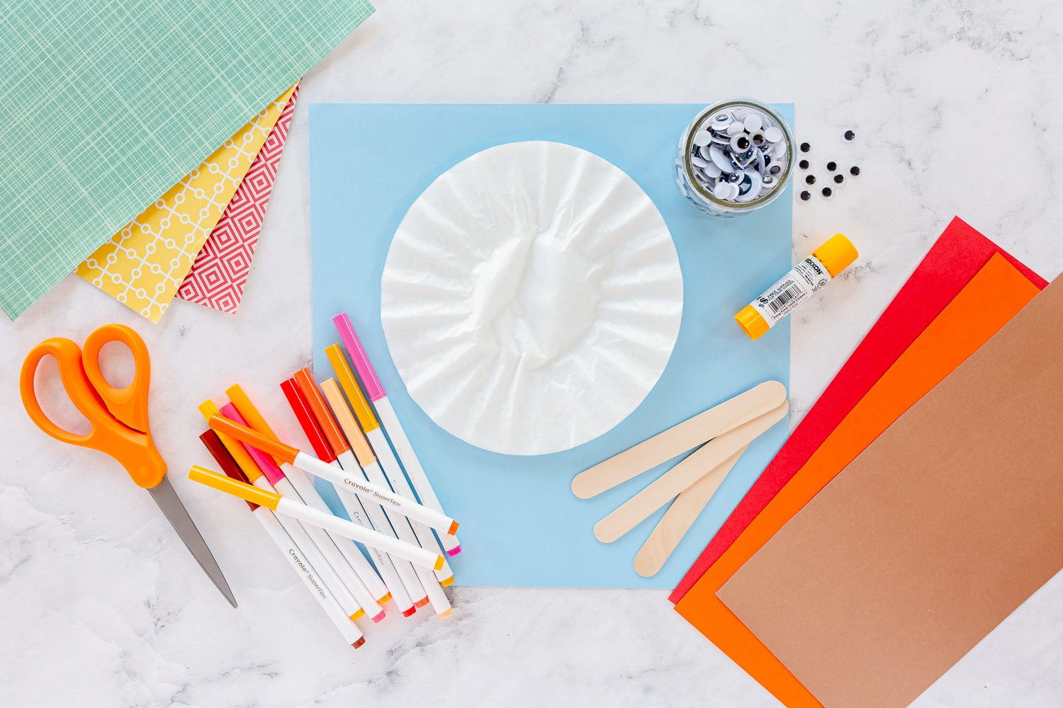 supplies: washable markers, coffee filters, jumbo popsicle stick, glue, googly eyes.
